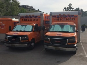 Water Damage Restoration Trucks At Job Location
