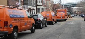Water Damage Restoration Vans And Trucks At Urban Job Location
