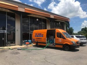 Water Damage Restoration Team At A Commercial Job Site