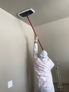 A Technician Conducting The Final Touches Of Water Damage Cleanup