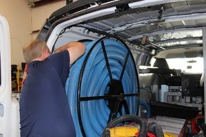 A Technician Prepping Water Extraction Equipment